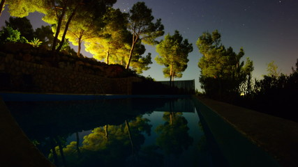 moon rise over swimming pool at night Majorca