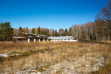 rusting broken down farm house on rural Russia
