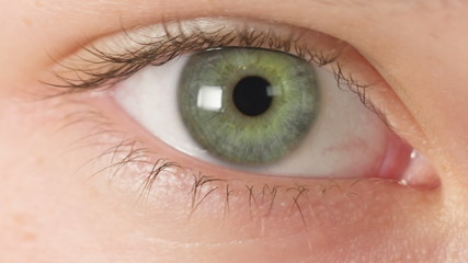 female teen eye close up, open and blinking