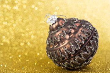 christmas decoration on abstract yellow glitter background
