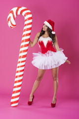 Sexy santa claus with candy cane