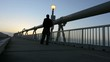 Man walks over the Gold Coast Pier in Queensland Australia.