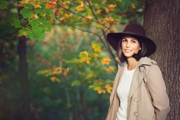 Beautiful woman portrait among autumn colors