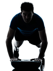 man exercising bosu push ups workout fitness posture silhouette
