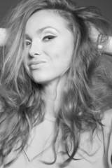 Beautiful redhead woman posing at the studio - BW
