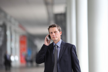 businessman talking on the phone during a business travel