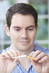 Man Using Electronic Cigarette To Stop Smoking