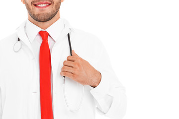 Midsection of a doctor holding stethoscope