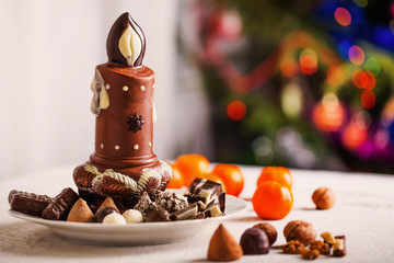 Chocolate candle on background Christmas tree