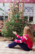 girl sitting at Christmas tree