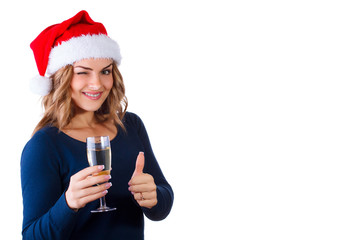 beautiful young woman with champagne in the hat of Santa Claus