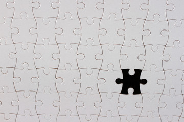 Puzzle piece on black background,the missing piece