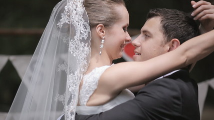 Newlyweds kissing in a nicely decorated with letters park