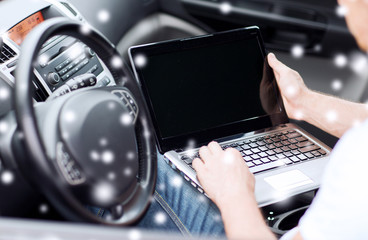 close up of man using laptop in car