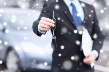 close up of man with car key outdoors