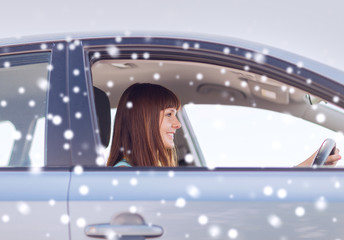 close up of smiling businesswoman driving car