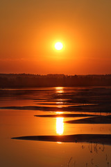 beautiful sunset with waved river sand beach