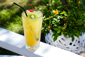 tropical cocktail with kiwi and cherry