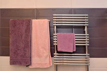 Terry towels hang in a bathroom