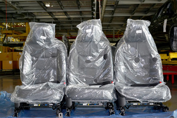 Automobile chairs in packing stand in assembly shop of automobil