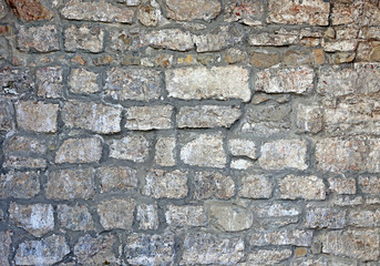Texture of the ancient gray brick wall