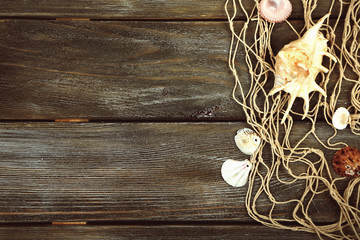 Decor of seashells on wooden background