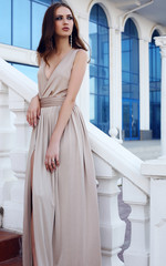 beautiful woman with dark hair in elegant beige dress