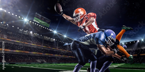 American football player in action at game time - 71832396