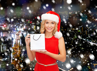 woman in santa helper hat with shopping bag
