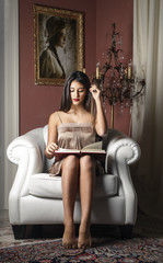 Classy woman glancing through a book