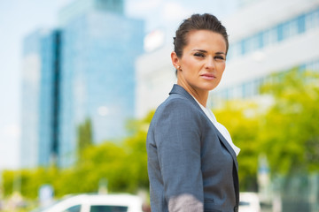 Portrait of confident business woman in office district