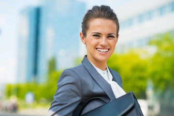Portrait of smiling business woman with briefcase