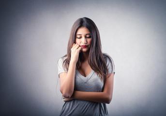 Sad girl thinking of something