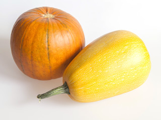 Two pumpkins, orange and yellow