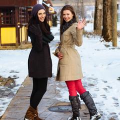 Girlfriends waving