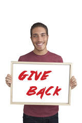 happy young man showing board with text: Give back Campaign