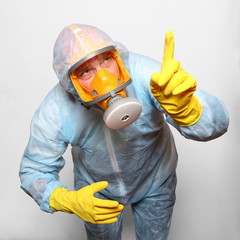 Man in protective clothing with respirator. Infection control.