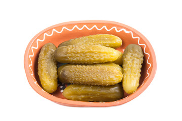 pickled cucumbers in traditional ceramic bowl isolated on white
