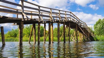 wooden bridge across the river
