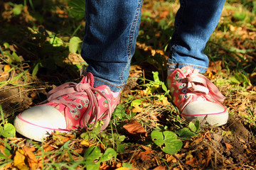 Colored shoes on the feet of the child.