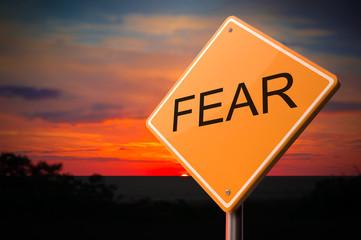Fear Inscription on Warning Road Sign.