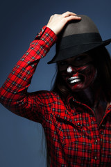 Studio photo of adult woman with scary make up for halloween