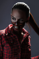 Vertical photo of adult girl with scary halloween style face art