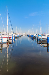 Port of Cervia with boats and yachts on the quay, Italy.