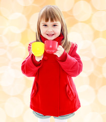 Charming little girl in a red coat