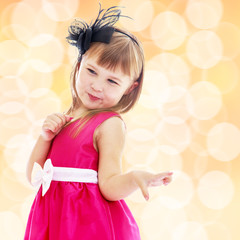 Charming little girl in a pink dress