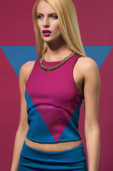 Blonde fashion woman on colorful dress