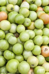 Pickle green tomatoes in a supermarket