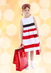 Pretty little girl goes shopping