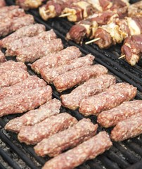 Minced meat rolls on grill
